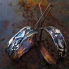 Kolczyki metaloplastyka
